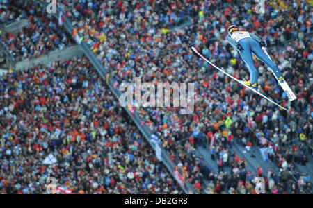Finnish ski jumper Janne Ahonen soars over the heads of the spectators during his jump in Oberstdorf, Germany, 30 - Stock Image