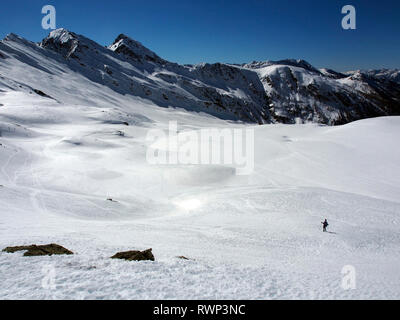 Snowshoeing below Bric Bouchet, Parc regional du Queyras, French Alps - Stock Image