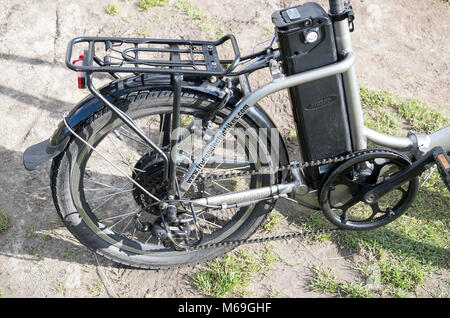 Power unit and battery on a FreeGo Folder electric assisted bicycle in UK - Stock Image