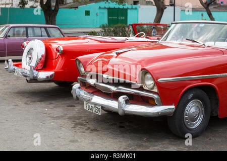 Cuba, Havana, Old Havana. Bright red vintage cars. Credit as: Wendy Kaveney / Jaynes Gallery / DanitaDelimont.com - Stock Image