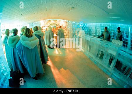 Tourists drinking frosty cocktails at Ice Bar in Nordic Sea Hotel in Stockholm - Stock Image