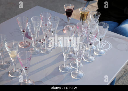 Many empty port wine glasses and two filled glasses on a winery table in Vila Nova de Gaia in Porto, Portugal Europe EU  KATHY DEWITT - Stock Image