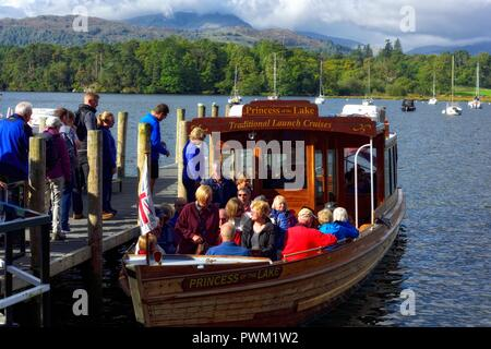 Waterhead boat jetty,tourists boarding princess of the lake for a boat trip on lake windermere,Ambleside,Lake district,Cumbria,England,UK - Stock Image