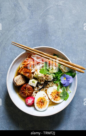 Japanese miso ramen with stuffed mushrooms, noodles and egg - Stock Image