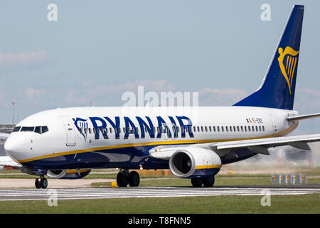 Ryanair Boeing 737-800, registration EI-EBZ, preparing for take off at Manchester Airport, England. - Stock Image