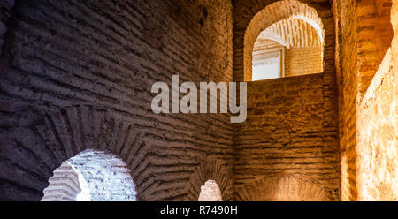 Dark mysterious shaft in an old building made of roughly hewn bricks - Stock Image