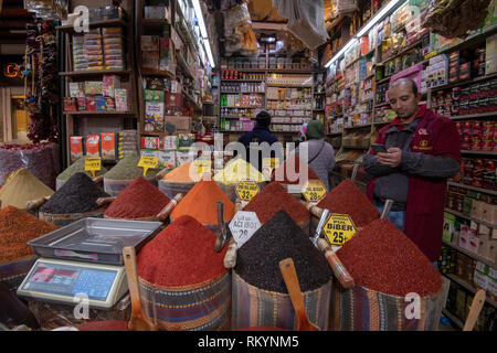 Large pots of colourful spices for sale in the Grand Bazaar in Istanbul in Turkey. - Stock Image
