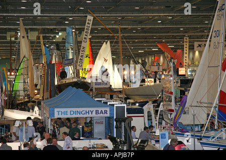 A view across the london boat show from  high up, showing the bars and people viewing the boats - Stock Image