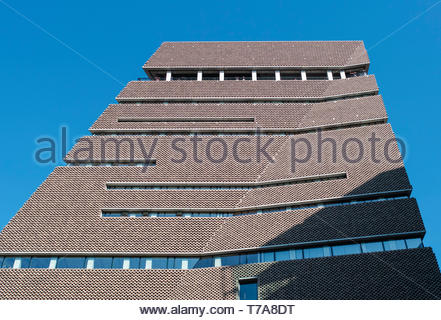 People look out from the viewing gallery of the Switchhouse extension to Tate Modern: Bankside, London. - Stock Image