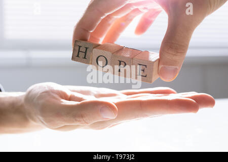 Close-up Of Person's Hand Giving Hope To Other Person - Stock Image