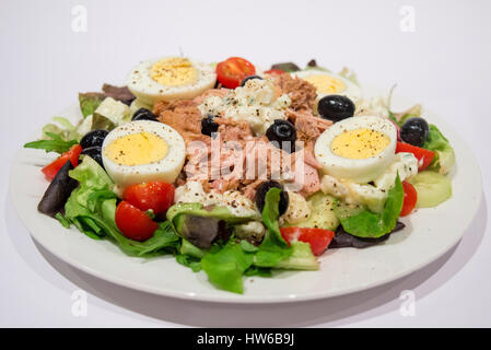 Salad nicoise with tuna olives egg potato tomato and fresh lettuce - Stock Image