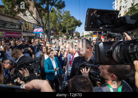 BELGRADE, SERBIA - SEPTEMBER 16, 2018:  Prime Minister Ana Brnabic (on the left) discussing with a volunteer during the 2018 edition of Belgrade Gay P - Stock Image