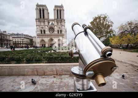 Binoculars pointed at Notre Dame Cathedral Paris France - Stock Image