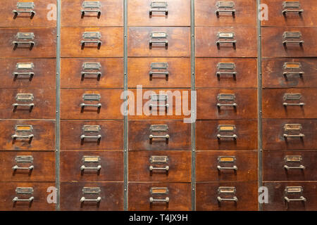 Vintage herbal medicine cabinet wood background, locker chinese style. - Stock Image
