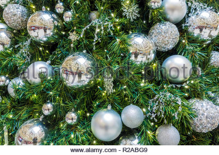 Christmas tree decorated with Christmas decorations. - Stock Image