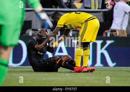 Mapfre stadium, USA. 23rd April, 2016. .Columbus Crew SC defender Harrison Afful (25) checks on Houston Dynamo midfielder - Stock Image