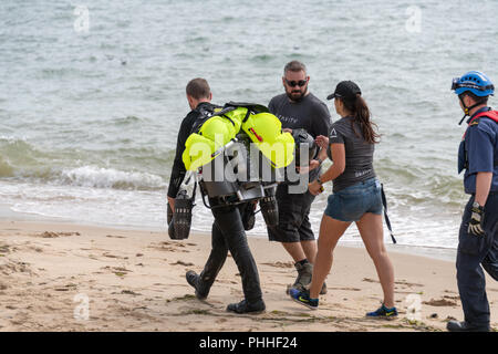 Bournemouth, UK. 1st September 2018. Richard Browning, the founder of Gravity Industries, has a malfunction at Bournemouth Air Festival and ends up crashing into the sea in his jet suit. He is uninjured and walks away with a very wet piece of kit. Part of the annual Air Festival in Bournemouth, Dorset. Credit: Thomas Faull/Alamy Live News - Stock Image