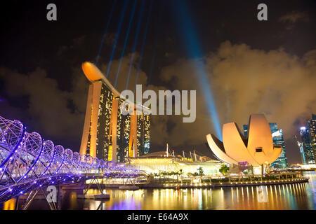 Helix bridge, Marina Bay Sands Hotel & Art Science museum at dusk, Singapore, SE Asia - Stock Image