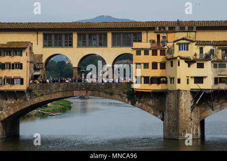 The Ponte Vecchio or Old Bridge in Florenze Italy is one of the major tourist attractions. Originally butcher shops lined the bridge now jewelers sell - Stock Image