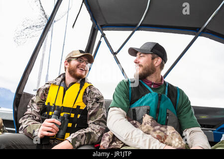Tourists In Life Vests On A Boat, Seward, Southcentral Alaska, USA - Stock Image