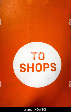 To Shops painted sign in orange and white - Stock Image