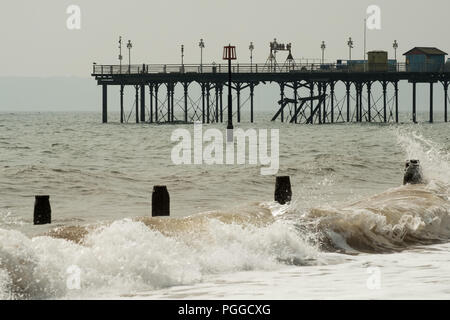 Teignmouth Grand Pier during winter gales on the beach, Devon, England, UK. - Stock Image