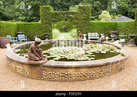 Lily pond at the The Walled garden plant nursery, Benhall, Suffolk, England, UK - Stock Image