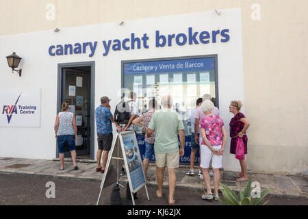 LANZAROTE, SPAIN-4th Nov 2017: A group of tourists take interests in a range of yacts that are on sale at the Canary - Stock Image