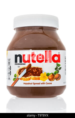 Winneconne, WI - 15 May 2019 : A jar of Ferrero Nutlella hazelnut spread with cocoa on an isolated background - Stock Image
