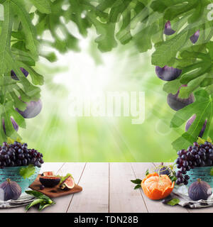 Natural morning background. Sweet Fruit on wooden table in green fig tree sunlight garden. - Stock Image