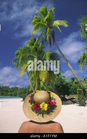 South pacific Cook Islands Aitutaki lagoon One foot Island dream beach woman with strawhat and flowers - Stock Image