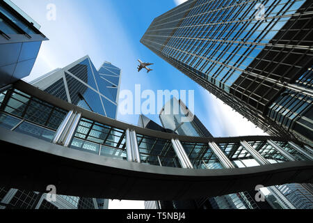 Modern business center in Hongkong. Skyscrapers in commercial area with airplane flying above at Hongkong. Asia - Stock Image