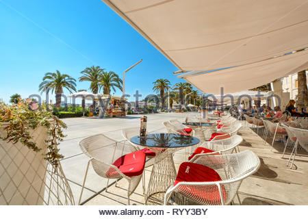 Afternoon view from waterfront sidewalk cafe at the Riva Promenade at the port of Split Croatia on the Dalmatian Coast of the Adriatic Sea - Stock Image
