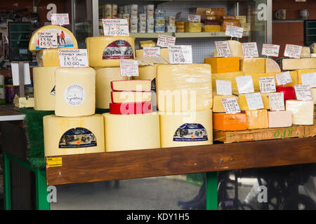 Purdons cheese stall on Bury market. The stall sells a wide range of traditional English cheese specialising in - Stock Image