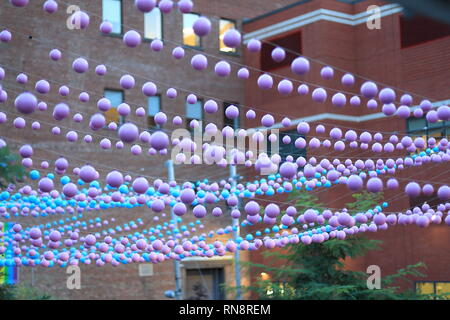 Quebec,Canada. Rainbow balls decorate Montreal's Gay Village along Ste-Catherine street. - Stock Image