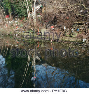 Flytipping from nearby industrial units, alongside a canal in central Birmingham, West Midlands, UK. - Stock Image