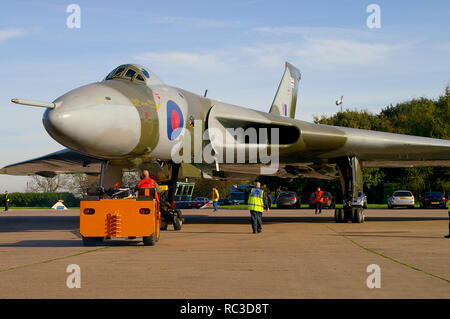 Avro Vulcan B2 XH558 jet bomber plane, ex RAF, restored to flight by Vulcan to the Sky, Vulcan Operating Company. Being pushed out for first flight - Stock Image