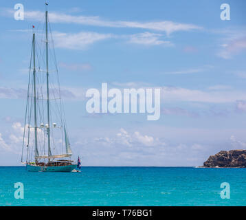 Large private sail boat at anchor off Saline Beach, St Barts - Stock Image
