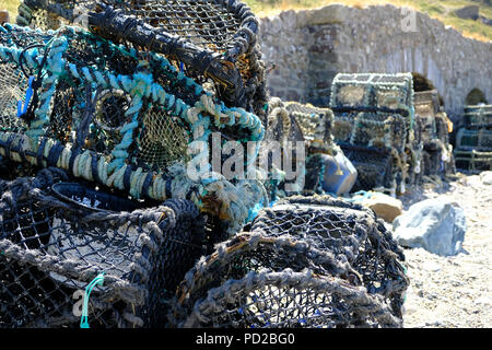 Bude, Cornwall, UK. Lobsters pots are stored near The Breakwater - Stock Image