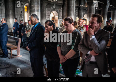 A church service takes place in the Immaculate Conception Church in Qaraqosh (Hamdaniya) Iraq which was destroyed - Stock Image