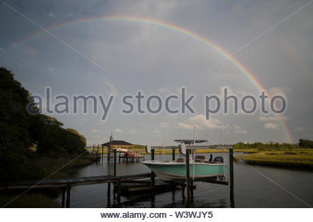 A double raindow appears over a North Carolina sound after a thunderstorm. - Stock Image