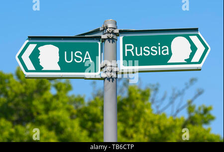 USA or Russia direction sign with depictions of USA President Donald Trump and Russian President Vladimir Putin on the sign. America vs Russia. - Stock Image