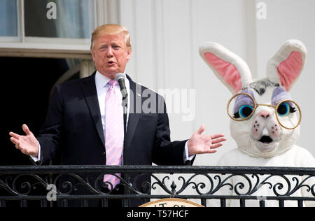 Washington, United States Of America. 22nd Apr, 2019. United States President Donald J. Trump, accompanied by the Easter Bunny, delivers remarks at the White House Easter Egg Roll at the White House in Washington, DC on April 22, 2019. Credit: Kevin Dietsch/Pool via CNP | usage worldwide Credit: dpa/Alamy Live News - Stock Image