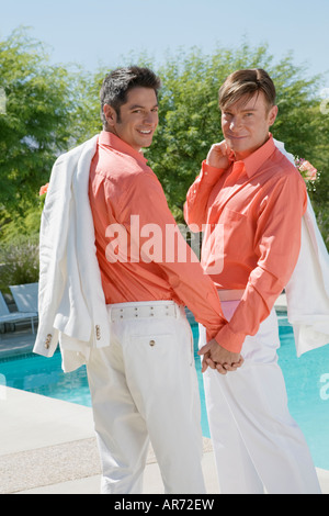 Newlywed gay couple holding hands - Stock Image