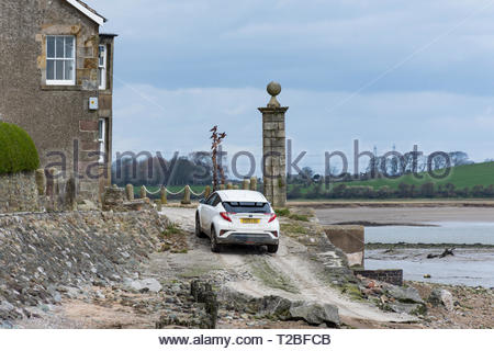 Difficult driving on the shore at Sunderland Point on the Lune Estuary near Lancaster. The village is cut off at high tides. - Stock Image