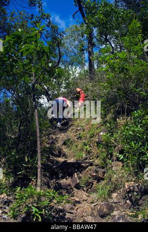 Trekkers on Agua Fria Waterfall Track Chapada dos Veadeiros Veadeiros Tableland Goias Brazil - Stock Image