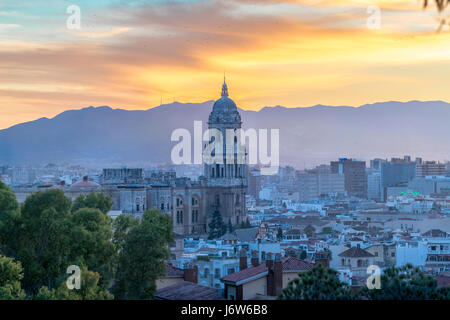 Malaga Cathedral with Old Town scenic view from Gibralfaro at sunset at twilight at dusk in the evening - Stock Image