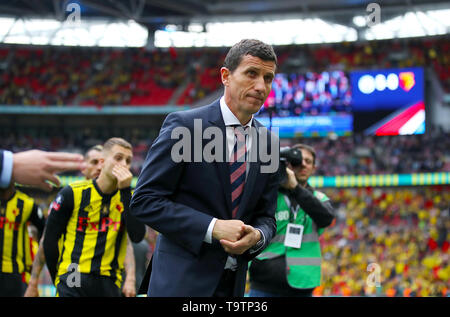 Watford manager Javi Gracia is shown the way to collect the runenrs up trophy during the FA Cup Final at Wembley Stadium, London. - Stock Image