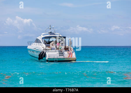 people on a boat at Saline Beach in St Bart's enjoying the day - Stock Image