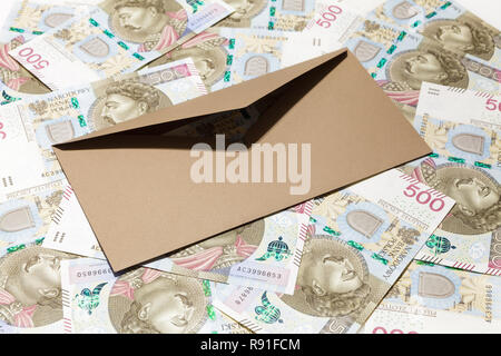 Brown opened envelope on 500 PLN banknotes background - Stock Image